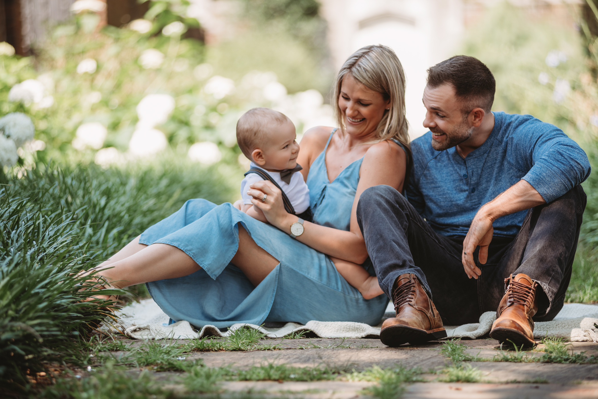 A family of three sitting in the park. Photo by Laura Mares Photography, Pittsburgh Family Photographer.