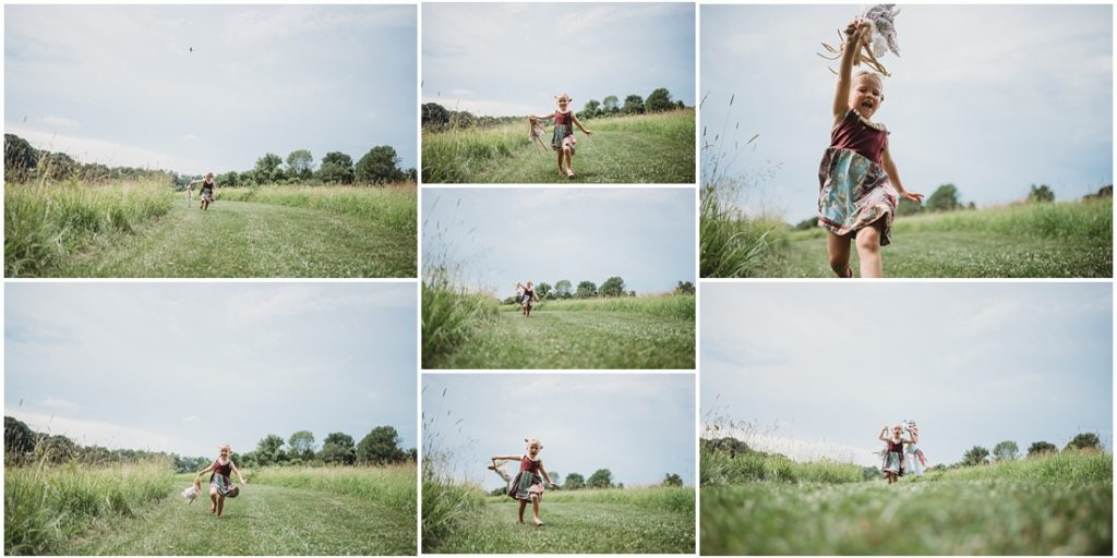 Ella running in a field with her favorite doll named Tutu. Photo by Laura Mares, a Pittsburgh Child Photographer.