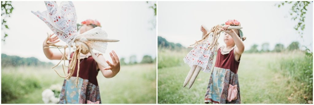 Ella playing with her favorite doll named Tutu. Photo by Laura Mares, a Pittsburgh Child Photographer.