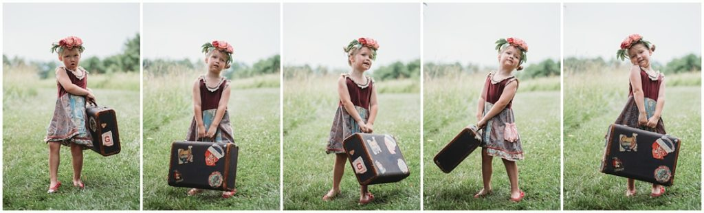 A girl holding a suitcase. Photo by Laura Mares, a Pittsburgh Child Photographer.