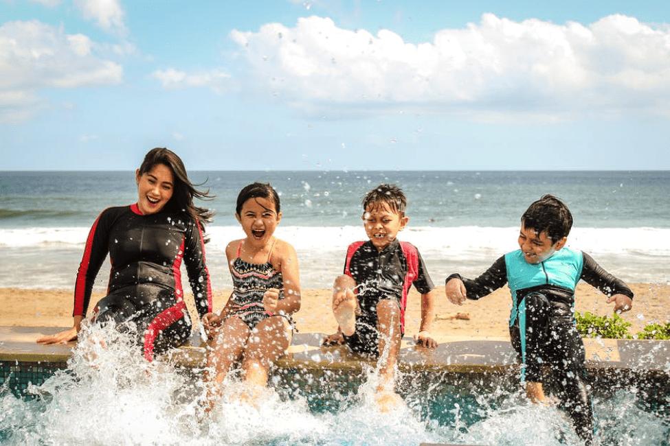 family splashing in the water