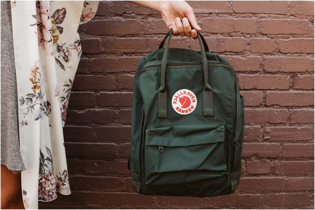 Girl holding a fjallraven Kanken backpack. Photo by Laura Mares Photography, Pittsburgh Lifestyle Photographer.