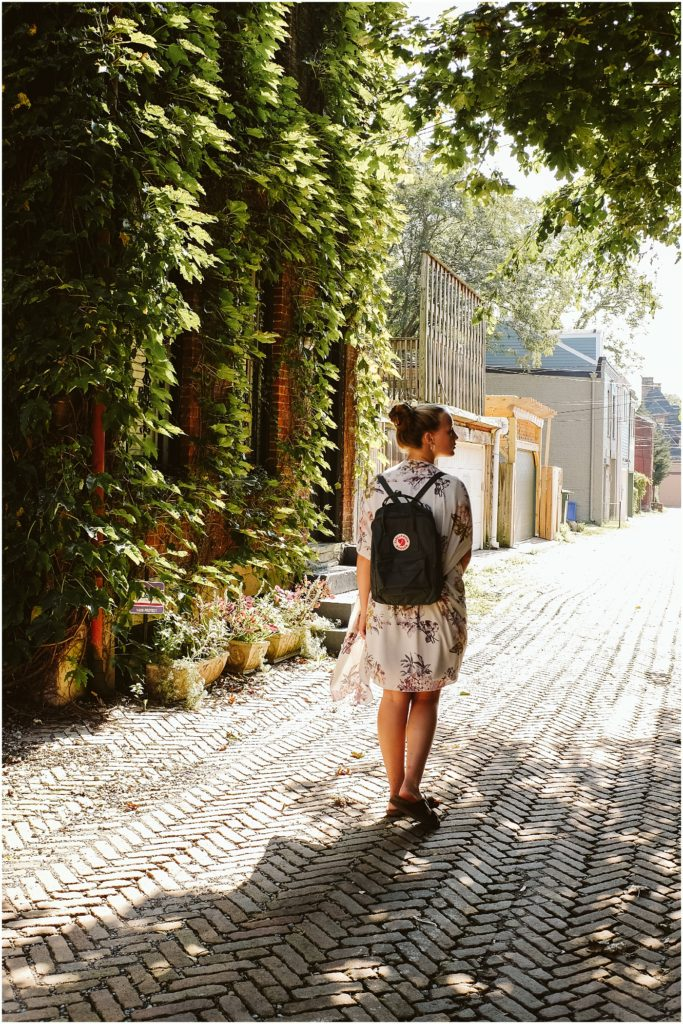 Girl walking on a brick street. Photo by Laura Mares Photography, Pittsburgh Senior Photographer.