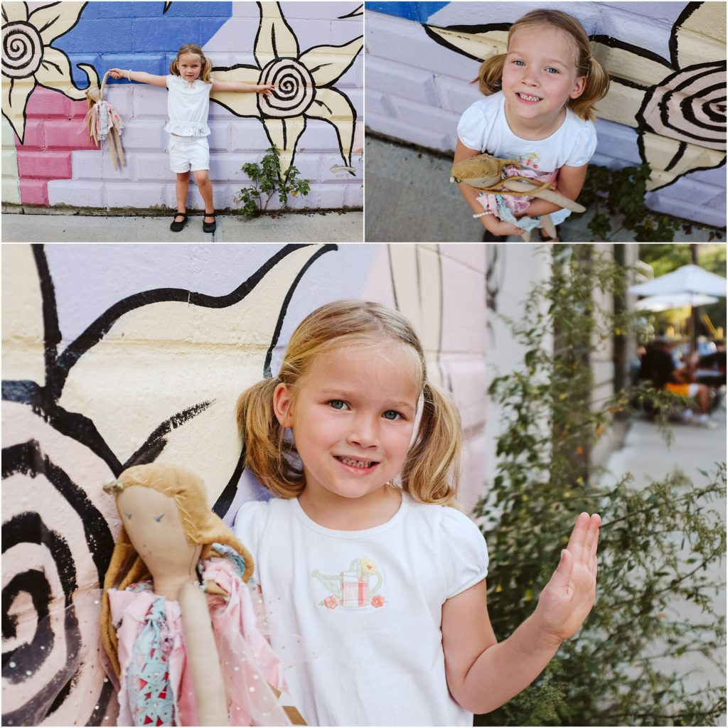 Girl standing in front of a painted mural. Photo by Laura Mares Photography, Pittsburgh Child Photographer.