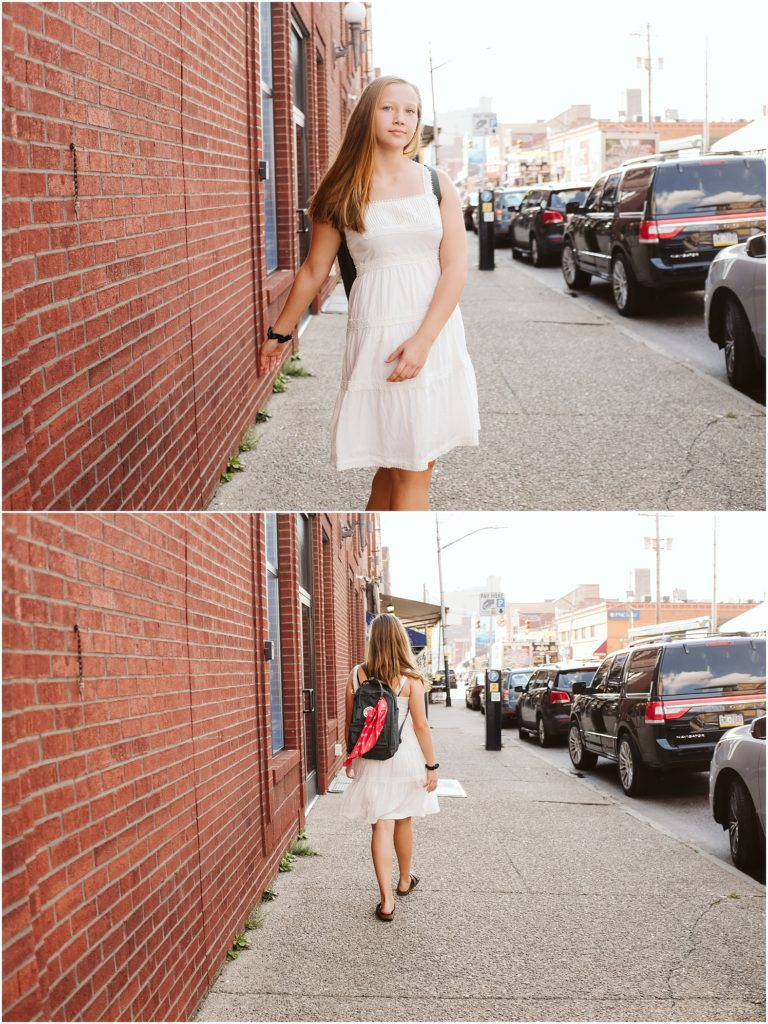 Girl walking in the strip district. Photo by Laura Mares Photography, Pittsburgh Senior Photographer.