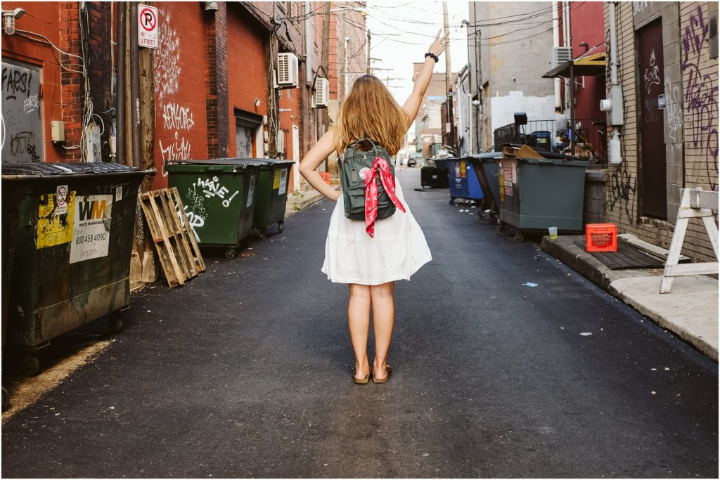 Girl standing in an alley in the strip district. Photo by Laura Mares Photography, Pittsburgh Senior Photographer.