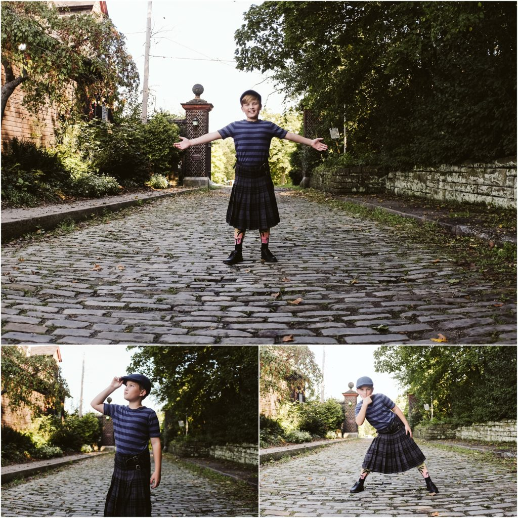 Boy standing on a cobblestone road wearing a kilt. Photo by Laura Mares Photography, Pittsburgh Child Photographer.