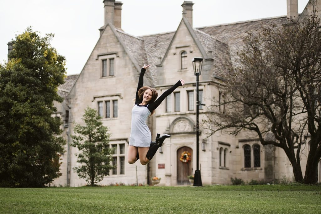 A portrait of a senior girl jumping for joy near Pittsburgh. Portrait by Laura Mares Photography, Pittsburgh Senior Photographer