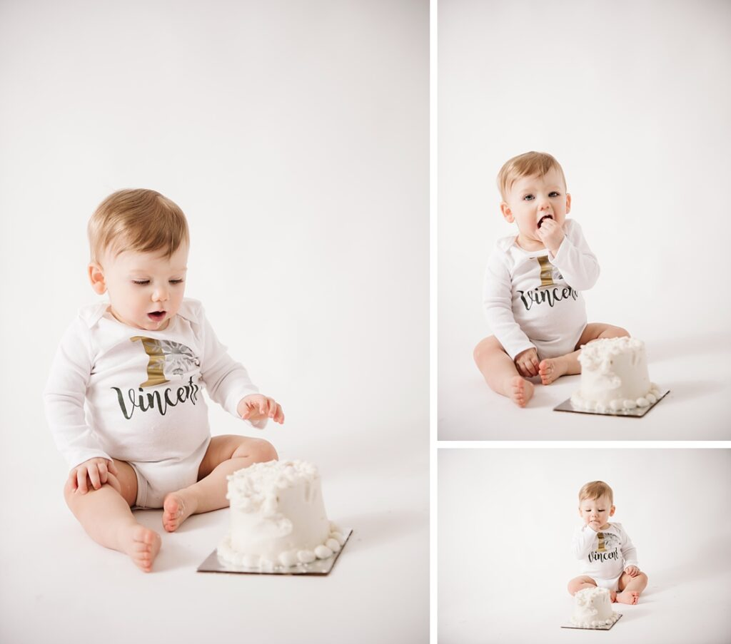 1st Birthday boy eating cake during his cake smash session. Photo by Laura Mares Photography, Pittsburgh Baby Photographer.