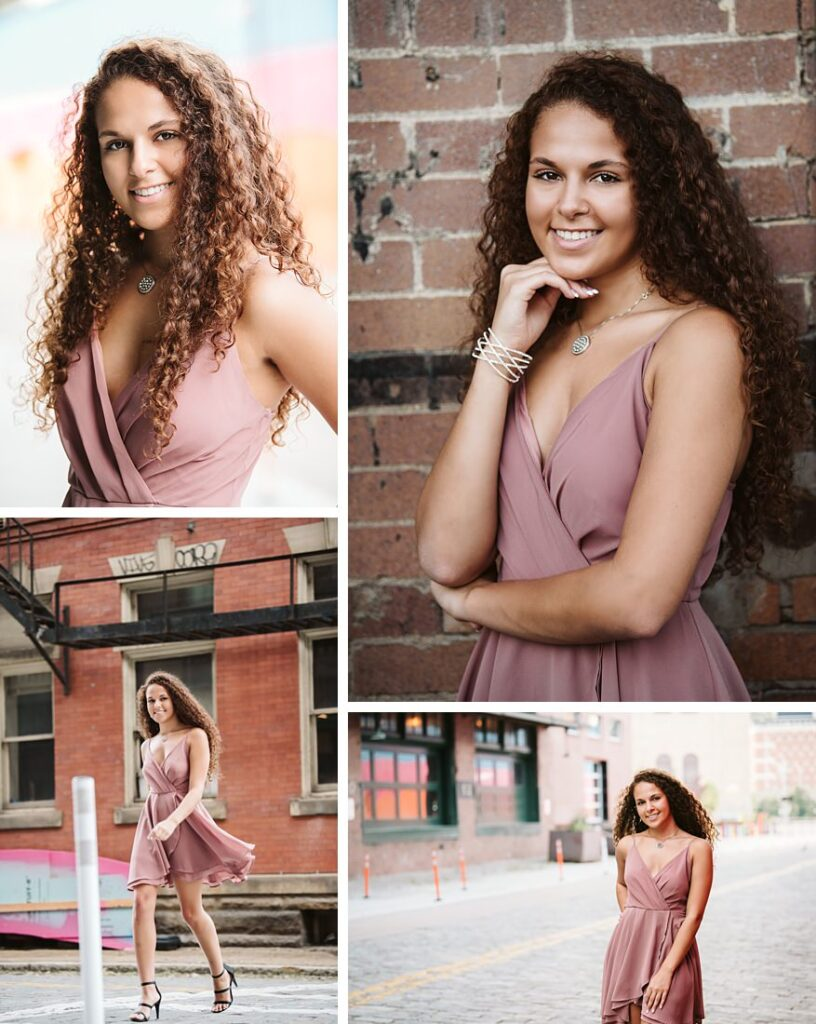 High school senior girl posing for senior photos in a pink dress in downtown pittsburgh