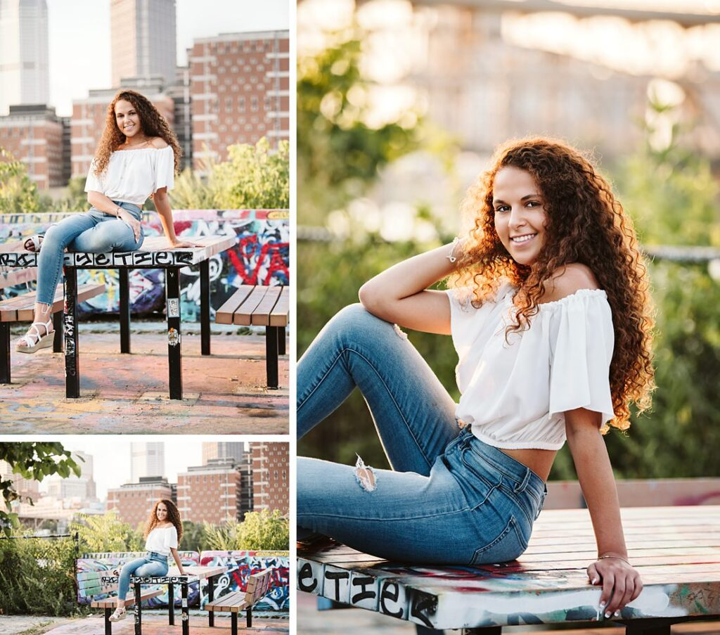 High school senior girl posing for senior photos in color park in downtown pittsburgh