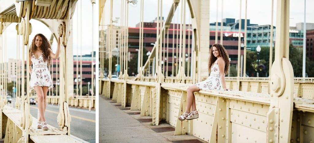 High school senior girl on the Roberto Clemente Bridge in Pittsburgh, PA during sunset