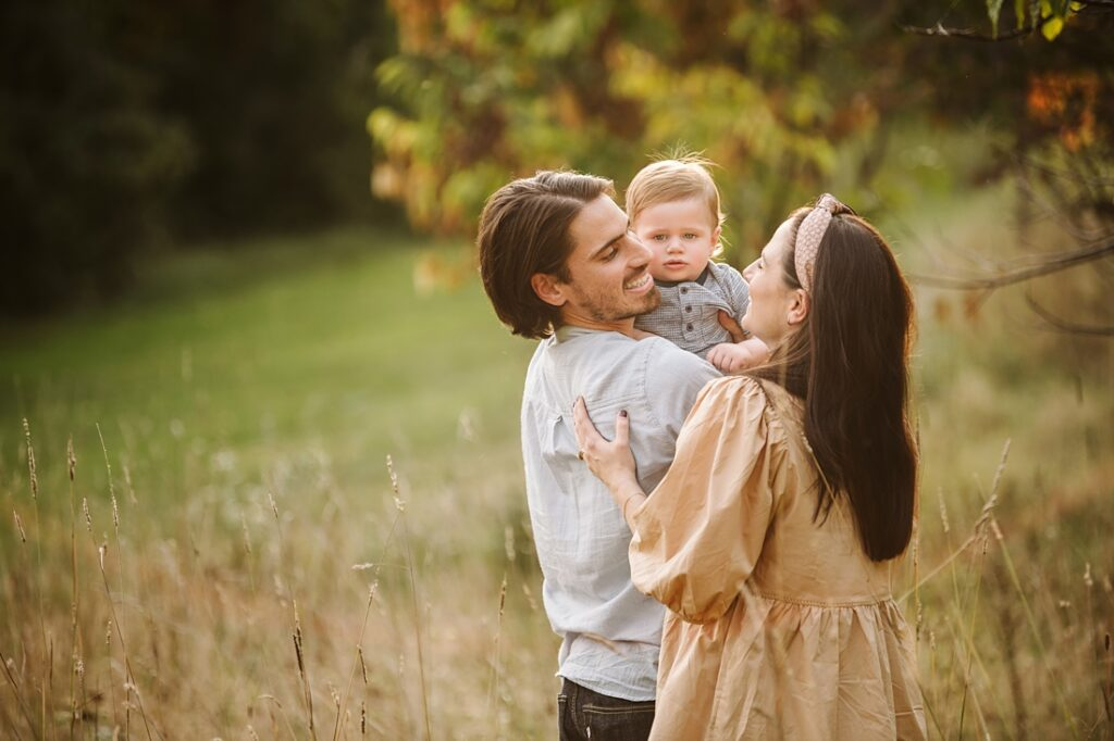 Family hugging during golden hour for a family photo session near Pittsburgh, PA