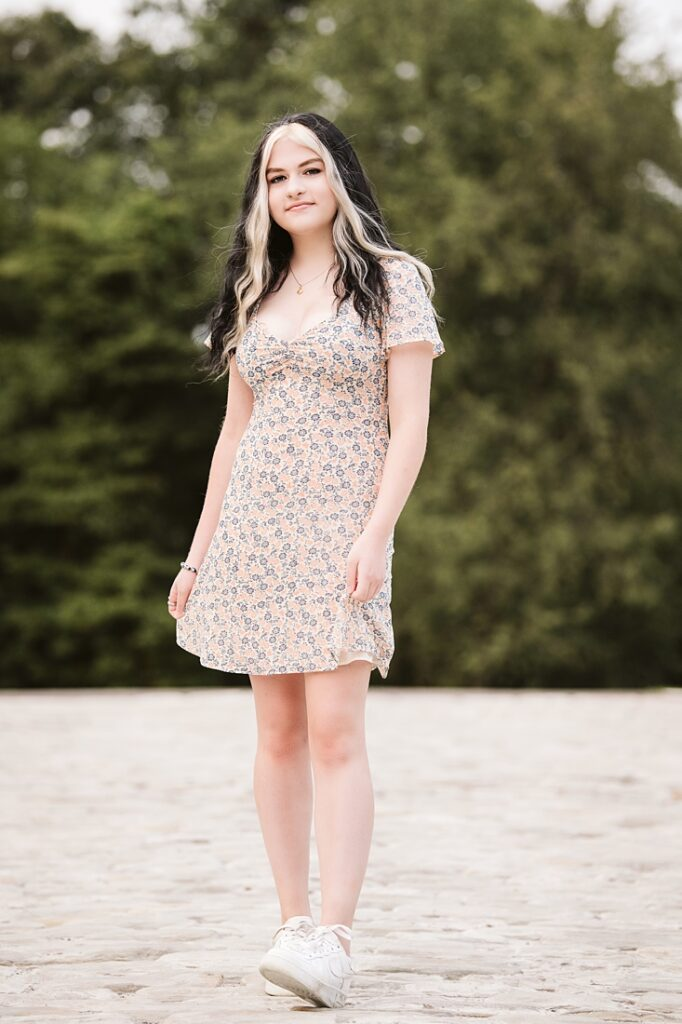 senior girl walking on a cobble stone driveway near Pittsburgh, PA during her senior picture session