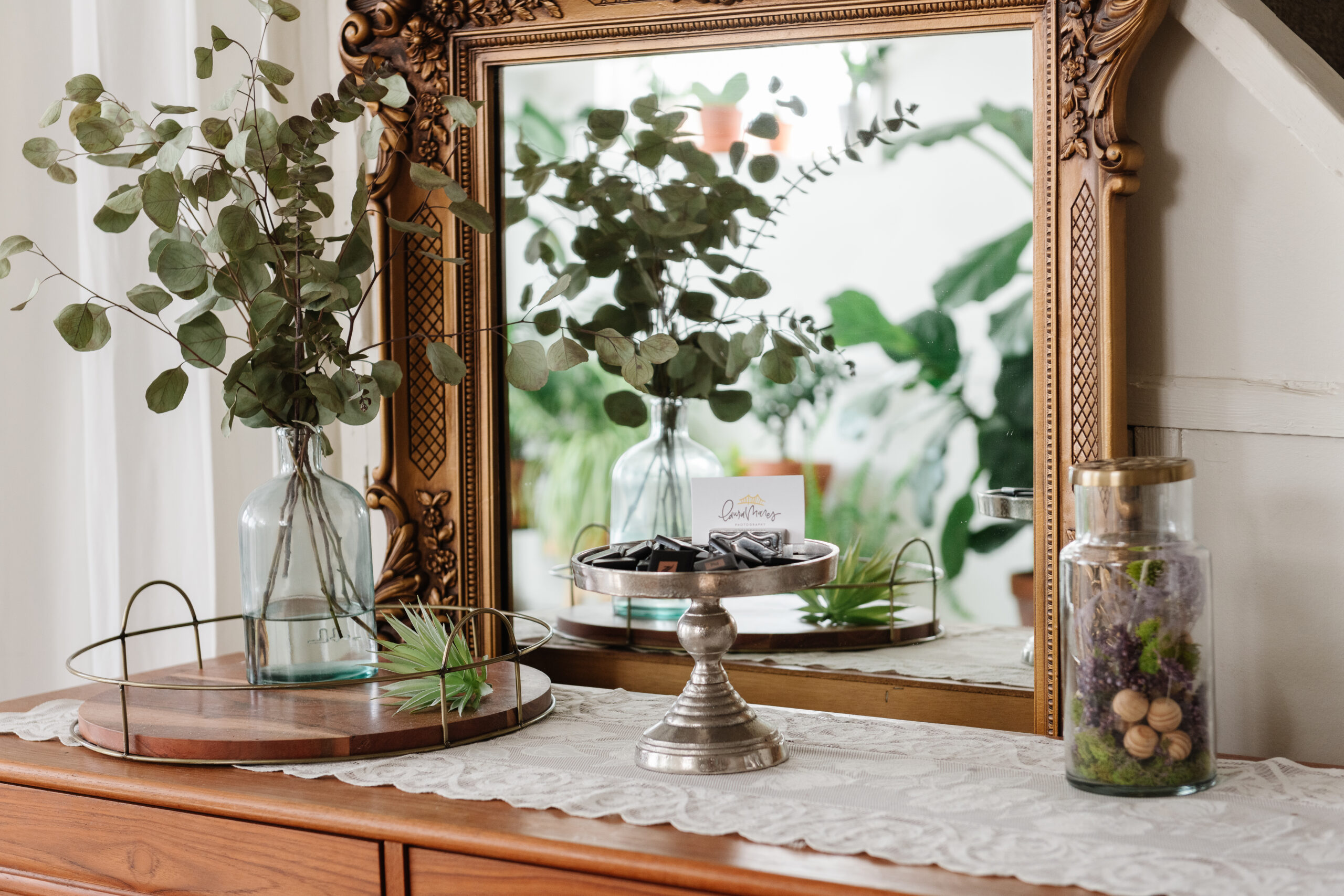 vintage mirror with greenery and dried flowers