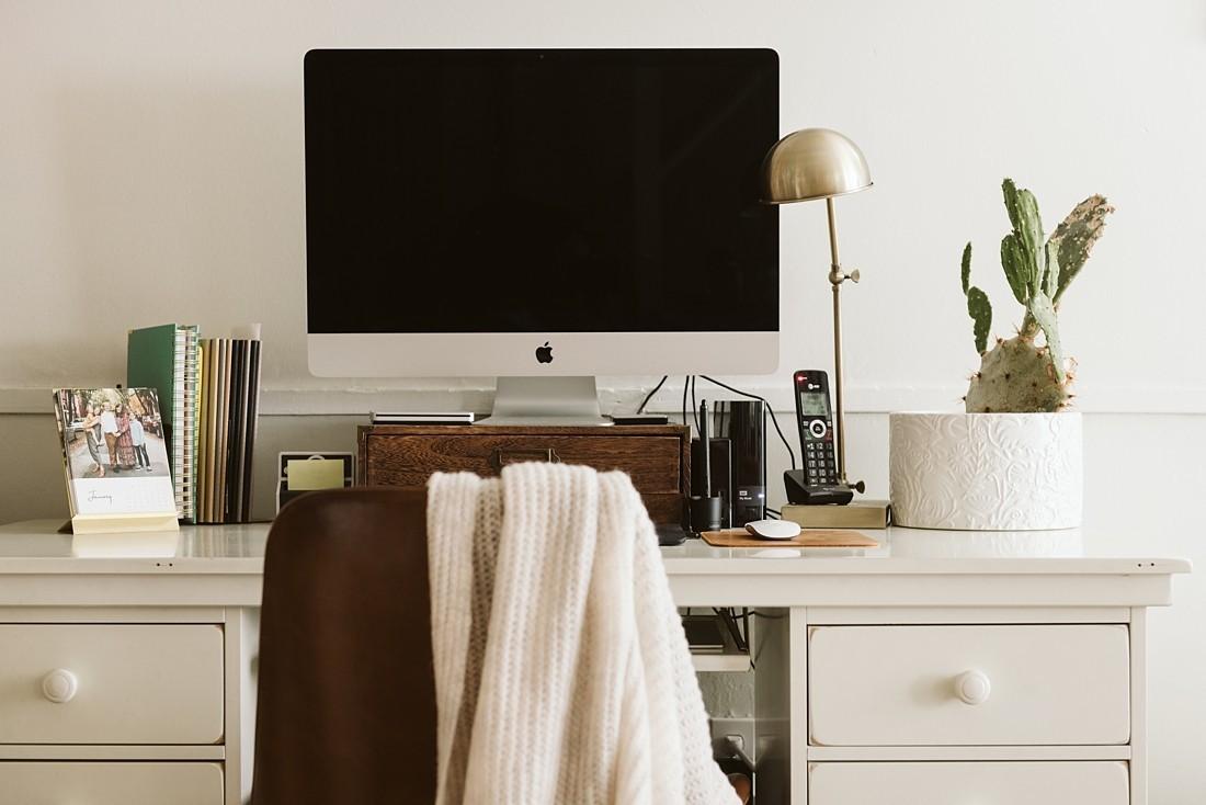 photo of a white desk, iMac, and cactus